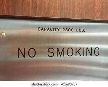 Capacity 2500 pounds no smoking elevator door sign