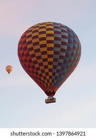 Capadocia, Rurkey, Feb. 13, 2019 : Hot air balloons fly high in the air, Gerome, Turkey