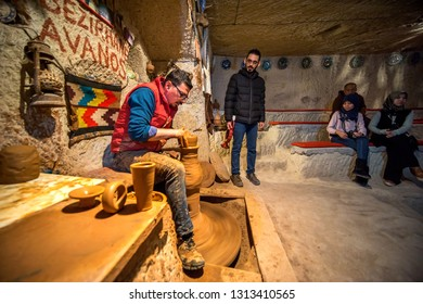 Capadocia, Turkey - Disember 10,2018:A pottery master demonstrating his skill in carving pottery with his hand. Capadoccia is popular with its pottery items for domestic use and as souvenir