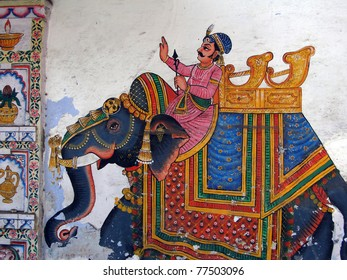 Caparisoned elephants on parade. painted on palace walls  Udaipur, India