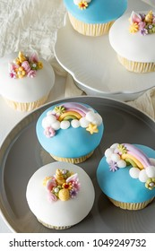 A capcake in the form of a unicorn, a rainbow. A feast for a little princess. White background