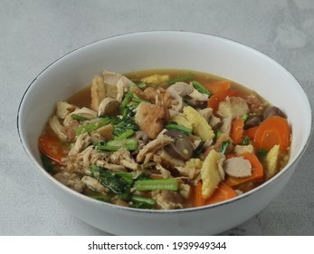 capcay aor cap caj is a dish that consists of a variety of vegetables and some meats - Shutterstock ID 1939949344