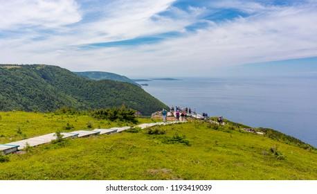 CAPE BRETON, NOVA SCOTIA, CANADA - JULY 19, 2018: Hikers on boardwalk on Skyline Trail in Cape Breton Highlands National Park.
