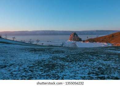 Cape Burkhan on Olkhon Island in winter that water in the lake to be ice at Baikal Lake in Siberia, Russia. (focus at the Shaman Rock)