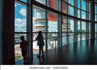 Cape Canaveral, Florida - August 13, 2018: Kids looking out at Atlantis Space Shuttle Rocket Booster at NASA Kennedy Space Center