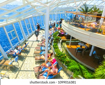 Cape Canaveral, USA - April 29, 2018: The people resting at Solarium on the Royal Carribean cruise ship Oasis of the Seas at Cape Canaveral, USA on April 29, 2018