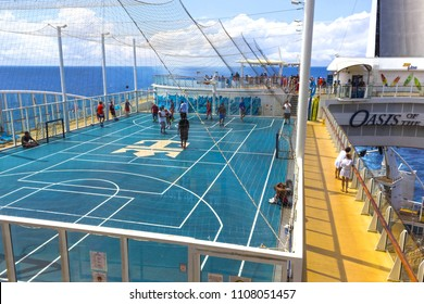 Cape Canaveral, USA - April 29, 2018: The people playing at upper deck with mini basketball court at cruise liner or ship Oasis of the Seas by Royal Caribbean docked in Cape Canaveral, USA on April 29