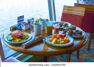 Cape Canaveral, USA - APRIL 29, 2018: The table with dishes at Dining Room Buffet aboard the luxury cruise ship Oasis of the Seas by Royal Caribbean.