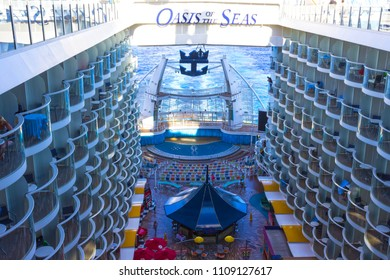 Cape Canaveral, USA - May 04, 2018: The Boardwalk, Aqua Theater amphitheater, climbing wall at cruise liner or ship Oasis of the Seas by Royal Caribbean docked in Cape Canaveral, USA on May 04, 2018.