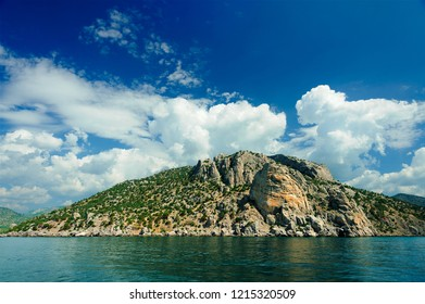 Cape Chiken-Kaya in the vicinity of the village of Novy Svet, Sudaksky District, Republic of Crimea, Russia. View from the sea. July 2018
