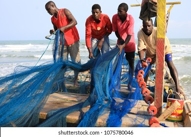 CAPE COAST - GHANA - JULY 28, 2017: Unidentified fishermen on July 28, 2017 in Cape Coast, Ghana. Illegal fishing by foreign vessels threatens the traditional fishing villages in Ghana.