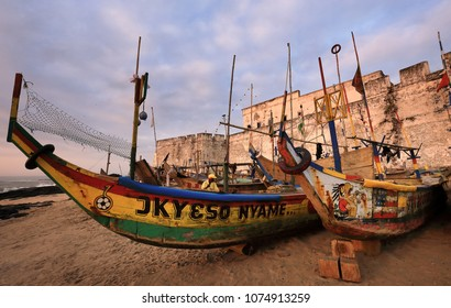 CAPE COAST - GHANA - JULY 31, 2017: Colorful fishing boats in front of Fort William in Anomabu near Cape Coast on July 31, 2017 in Cape Coast, Ghana
