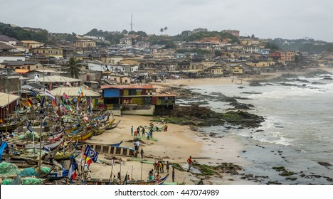Cape Coast, Ghana - July 31, 2014: Fisherman village in Ghana, near to the Cape Coast. Traditional Ghanaian fisherman boats parked at the small bay. Photo was taken from the Cape Cost Castle.