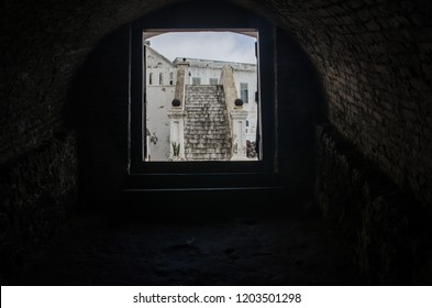 Cape Coast, Ghana - September the 23rd 2018. A view from a dungeon to a courtyard of Cape Coast Castle.