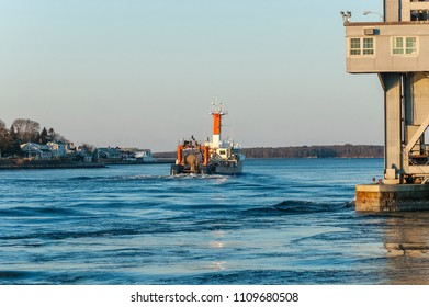 Cape Cod Canal, Massachusetts, USA - March 4, 2007: Fishing vessel Sunlight on Cape Cod Canal in dawn light