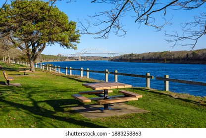Cape Cod Canal River Bank with Table and Benches on Fenced Green