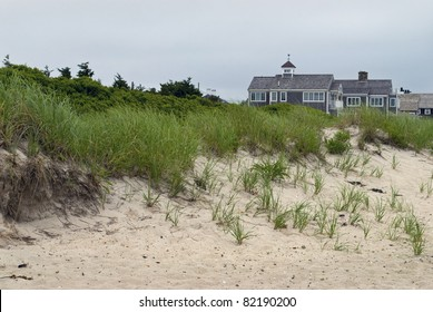 """""""Cape Cod Homes and Dunes""""  Sand dunes and homes along the beach in Cape Cod, Massachusetts."""