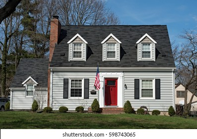 Cape Cod House with Three Dormers & Red Door