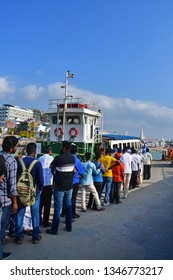 Cape Comorin (Kanyakumari), India, West Bengal (Tamil Nadu), March, 15, 2019. People stand in line for the ferry.India.  Small town on Cape Comorin (Kanyakumari). The southernmost point of India
