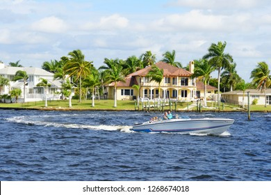 Cape Coral, Florida, U.S.A - December 3, 2018 - The view of the boat and waterfront home by the bay