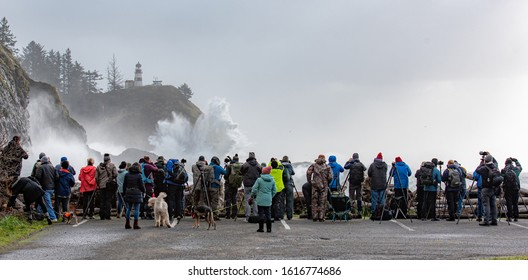 Cape Disappointment State Park, USA - January 11, 2020 Photographers line up for a winter storm of waves during a king tide.