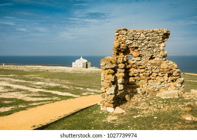 Cape Espichel chapel and ruin of old stone wall