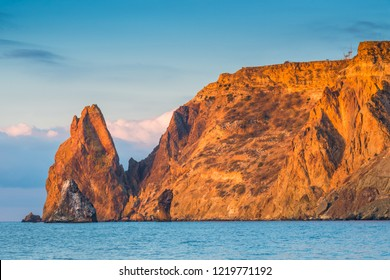 Cape Fiolent cliff against the backdrop of the sea in the sun at dawn in the morning, Russia, Crimea