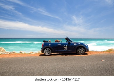 CAPE OF GOOD HOPE, SOUTH AFRICA - November 28, 2017: A MINI Cooper S Convertible rental car, owned by The Glen Boutique Hotel in Cape Town, parking at a beach with the roof down. MINI is owned by BMW.