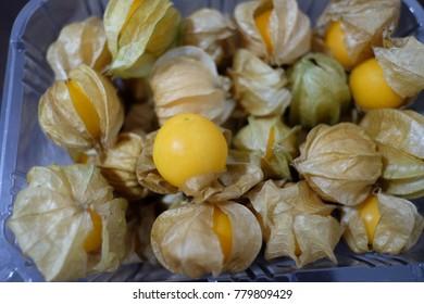 Cape gooseberries fruit in plastic box.