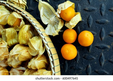 Cape gooseberries fruits with iron background