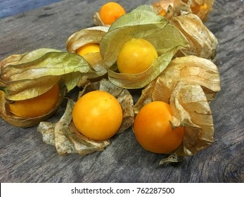Cape gooseberries on wooden background, Physalis fruit