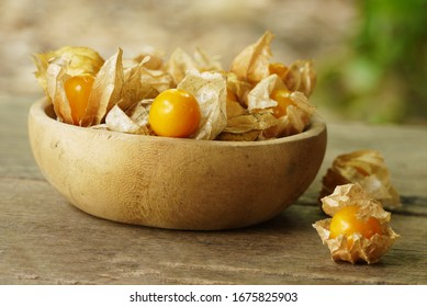 Cape Gooseberry on wooden floor texture with copy space  use for backgroud or wallpaper , selective  focus .