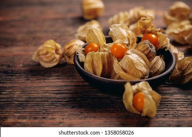 Cape Gooseberry, Physalis fruit or golden berry on vintage wooden background
