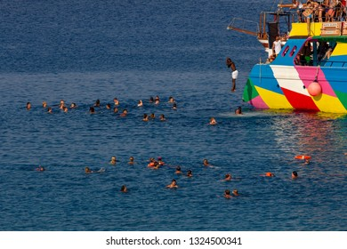 CAPE GRECO, AYA NAPA, CYPRUS - JULY 25, 2015: people jumping into water from boats.