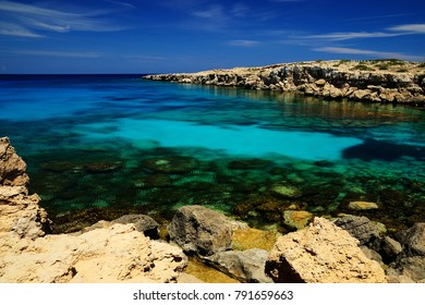 Cape Greco (Cavo Greco), Ayia Napa Municipality, Cyprus - May 09, 2011: Beautiful azur sea lagoon near Cape Greco.