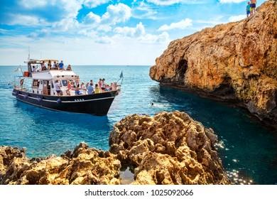CAPE GRECO,AYA NAPA, CYPRUS - OCTOBER 24, 2017: Pleasure boat on the Mediterranean sea. View of  lagoon near Cape Greko of Ayia Napa and Protaras on Cyprus island, Mediterranean Sea.