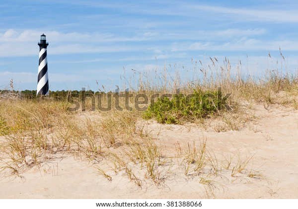 Cape Hatteras Lighthouse towers over beach dunes of Outer Banks island near Buxton, North Carolina, US