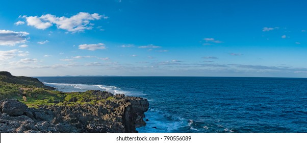 Cape Hedo is a scenic spot to experience the magnificent nature of Okinawa and it is located at the northernmost tip of Okinawa main island, Japan. Raging waves hit the cliffs of raised coral reefs.