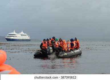 "CAPE HORN, CHILE - NOVEMBER 18,2014: Tourists disembark from cruise ship ""Via Australis"" on Cape horn. Cape Horn - the southernmost point of the archipelago of Tierra del Fuego."