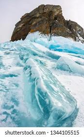 Cape Khoboy rock on Olkhon Island, Lake Baikal, ice hummocks in winter, Russia, Siberia
