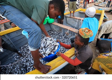 CAPE MACLEAR - MALAWI - AUGUST 6, 2015: Unidentified fishermen and market women trading fish on August 6, 2015 in the village Cape Maclear, Malawi