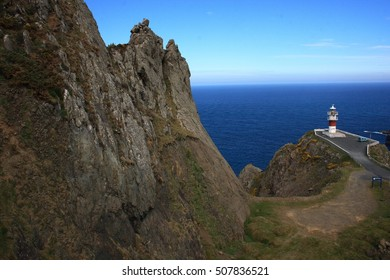 Cape Ortegal Lighthouse,tourist trip on board fishing boat by the Cape Ortegal, the Aguillons and the highest cliffs of Continental Europe, Galicia, Spain. Hatchery of barnacles, Concellos de Cariño