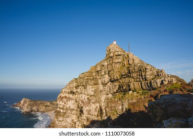 Cape Point view of rockface with lighthouse