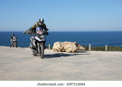 Cape Sages, Portugal, 02.23.2018. Biker rides with acrobatic elements. Off road motorcross training.