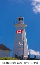 CAPE SPEAR, NEWFOUNDLAND, CANADA - JULY 26, 2018: Cape Spear Lighthouse National Historic Site, and Canadian flag.