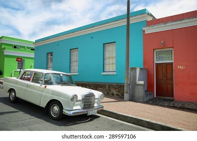 CAPE TOWN, COUTH AFRICA - DECEMBER 7: Colorful houses of Bo Kaap neighborhood and Merceder Benz with classical design parked in front on December 7, 2014 in Cape Town, South Africa