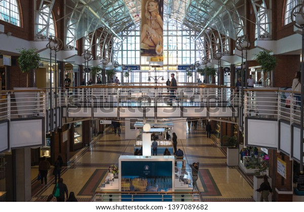 Cape Town - May 07, 2019:  V&A Waterfront shopping complex or mall interior on a week day with people going about their daily activities  and a popular destination for tourists and locals alike