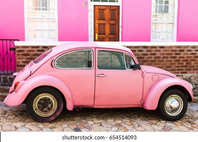 Cape Town, Republic of South Africa - April 20, 2014: pink car on the background of pink house, Bo-Kaap district