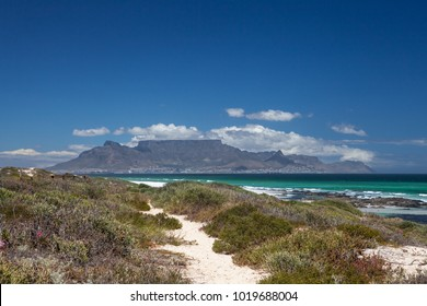 cape town scenic view of table mountain from blouberg with blue sky and white clouds in summer