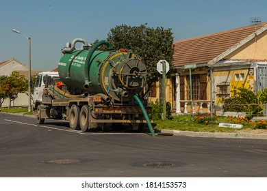 Cape Town, South Africa - 07 September 2020: Septic tank unblocking a drain in suburb. Essential Services, service delivery. Government workers.